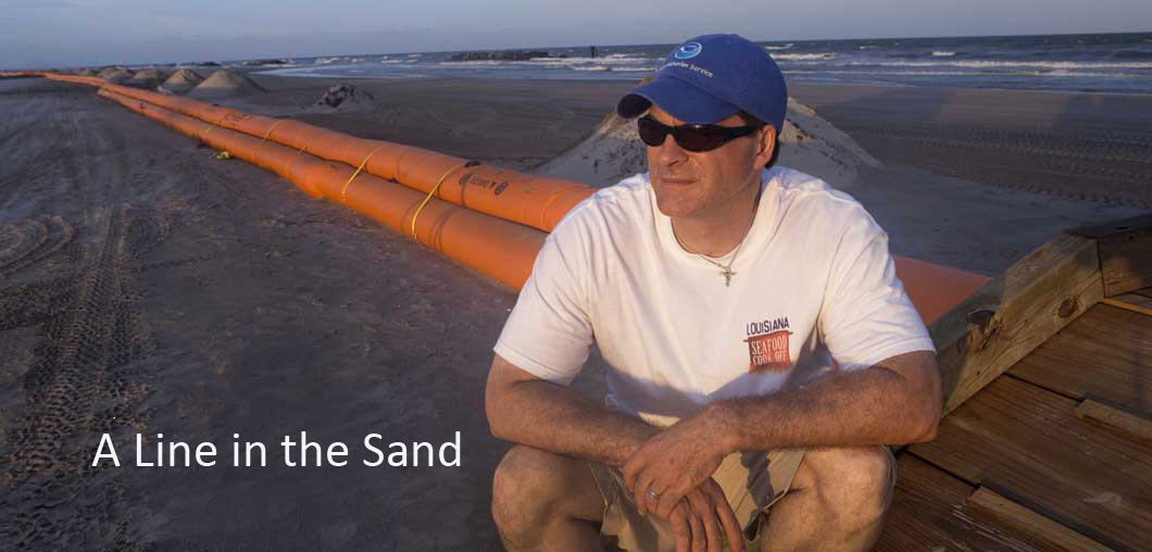 Line in the Sand: At the height of the Deepwater Horizon oil spill, Ewell Smith, executive director of the Louisiana Seafood Promotion and Marketing Board, sits on barriers keeping oil off the beaches of Grand Island, LA. Although his community was devastated by the disaster, Smith's leadership established a better working relationship between the oil and Louisiana commercial fishing industries after the crisis.